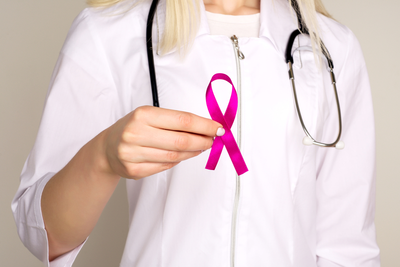 Female Doctor Holds Pink Ribbon, International Breast Cancer Day October 7 | © Isn5000 | Dreamstime Stock Photos