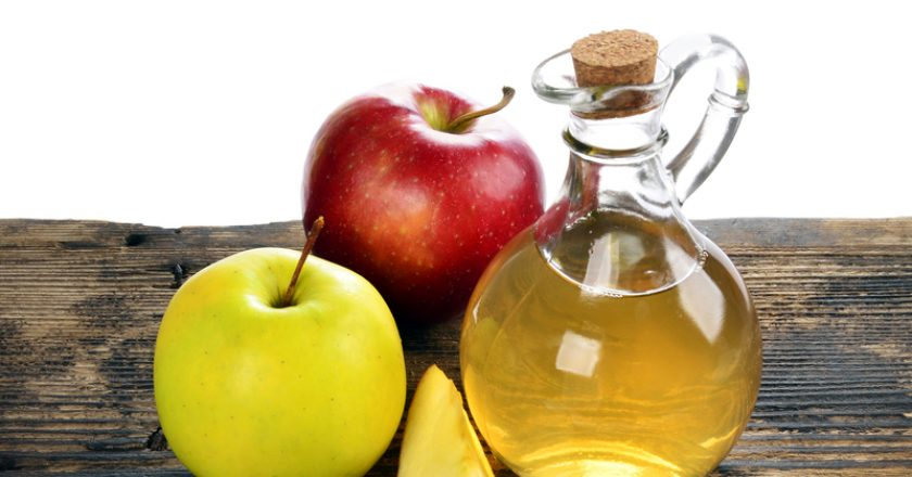 Apple cider vinegar in glass bottle |