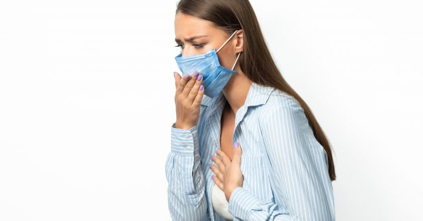 Sick Woman Coughing Having Breathing Difficulty On White Studio Background