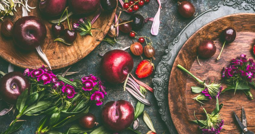 Summer seasonal fruits and berries with garden flowers in plates on dark rustic background   © Vicuschka   Dreamstime Stock Photos