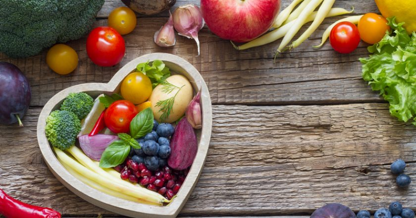Healthy food in heart diet cooking concept with fresh fruits and vegetables |