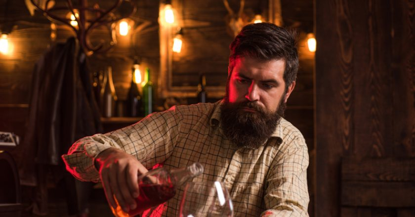 Man drinks brandy or whiskey. Bearded man wearing suit and drinking whiskey brandy or cognac. Sommelier tastes alcohol | © Tverdohlib | Dreamstime Stock Photos