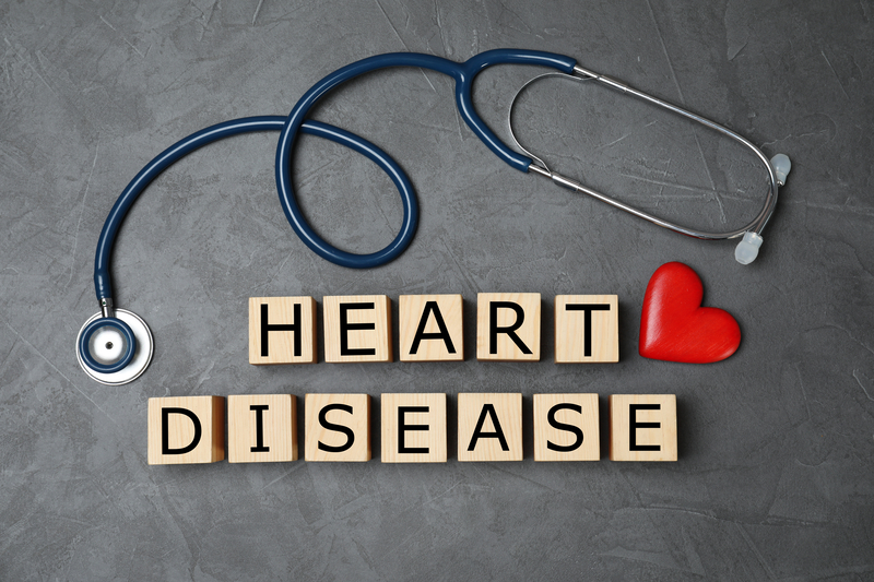 Wooden cubes with text Heart Disease and stethoscope on grey background | © Chernetskaya | Dreamstime Stock Photos