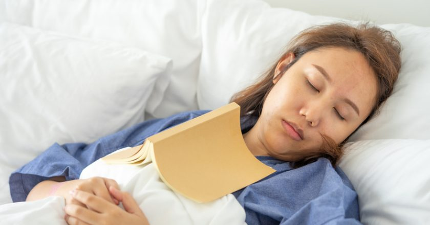 Asian girl Read books while sleeping. Man book cover Drowsiness causes sleep.The concept of adequate sleep. Good sleep | © Zasabe | Dreamstime Stock Photos