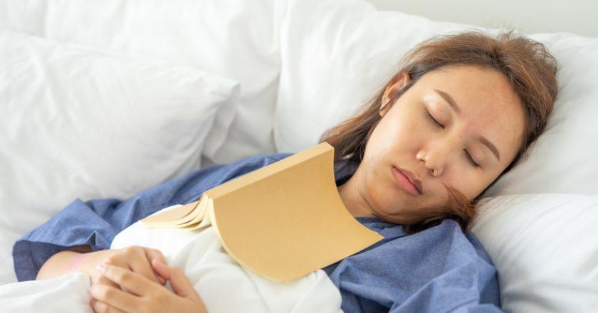 Asian girl Read books while sleeping. Man book cover Drowsiness causes sleep.The concept of adequate sleep. Good sleep   © Zasabe   Dreamstime Stock Photos