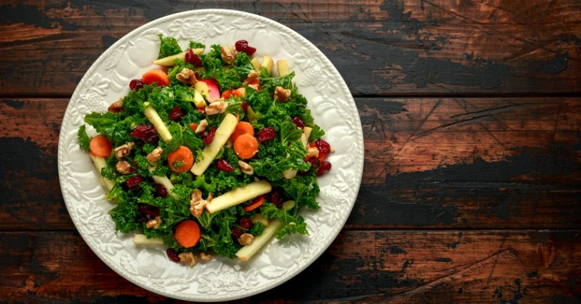 Kale salad with dried cranberry, carrots, walnuts and apple. healthy vegan food | © Funandrejs | Dreamstime Stock Photos