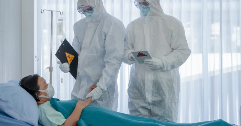 Coronavirus covid 19 treatment background of coronavirus covid 19 patient on bed with doctors in PPE coverall suit in hospital | © Akesin | Dreamstime Stock Photos