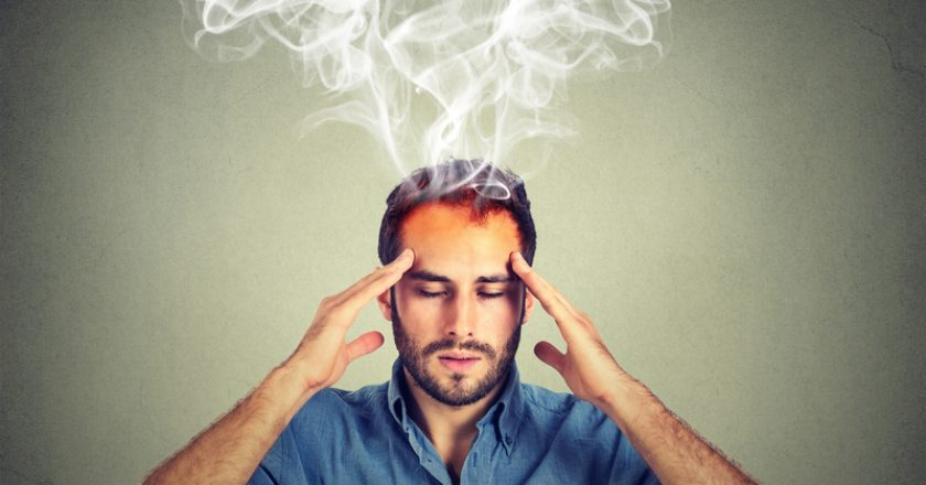 Man thinks very intensely having headache | © Kiosea39 | Dreamstime Stock Photos