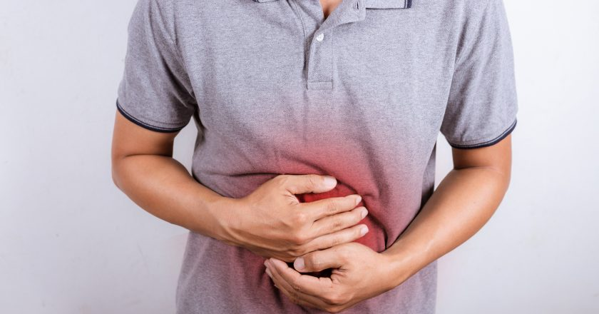 Man having painful stomach ache, enteritis. Health insurance concept