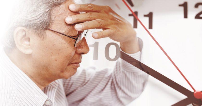 Man time losing his memory from amnesia.  Brain Stroke death clock | © Coffeekai | Dreamstime Stock Photos