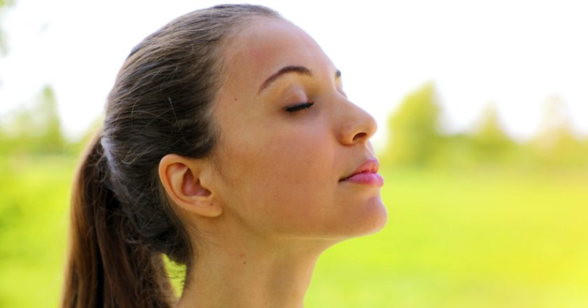Close up portrait of woman relaxing breathing fresh air deeply in the park | © Sergiomonti | Dreamstime Stock Photos