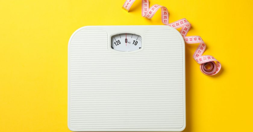 Scales and measuring tape on background. Weight loss concept | © Atlasfotoreception | Dreamstime Stock Photos