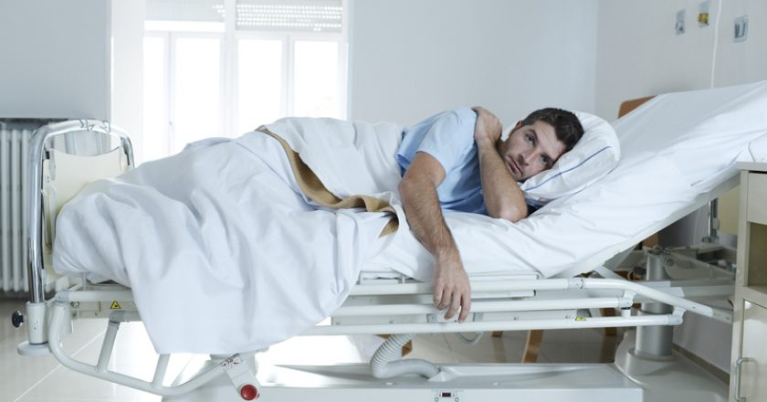 Desperate man at hospital bed alone sad and devastated suffering depression _ | © Ocusfocus | Dreamstime Stock Photos