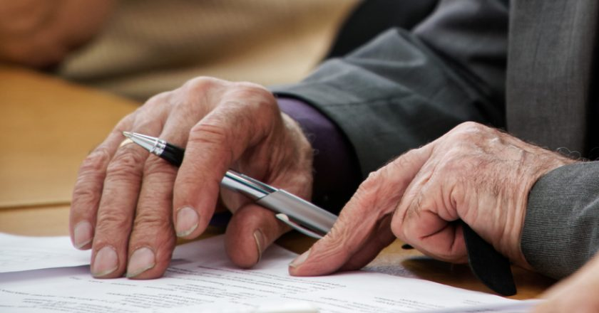 An elderly man writes a pen in the questionnaire. Old age and learning. Unemployment and retirement | © Miklmakmagnitka | Dreamstime Stock Photos
